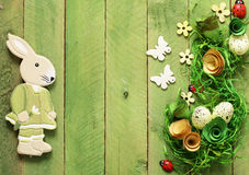 Wooden background with Easter symbols, eggs, butterflies Stock Image