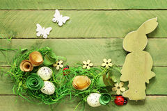 Wooden background with Easter symbols, eggs, butterflies, Royalty Free Stock Images