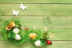 Wooden background with Easter symbols, eggs, butterflies, Stock Photography