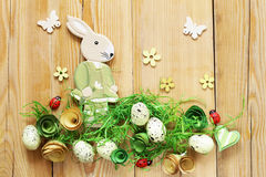 Wooden background with Easter symbols, eggs, butterflies, Royalty Free Stock Photo