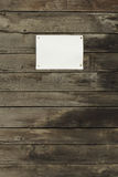 Wooden background with empty paper Royalty Free Stock Images