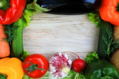 A wooden background framed with vegetables royalty free stock image