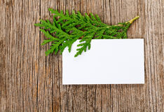 Wooden background with empty white card Stock Image