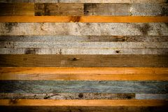 Wooden background from the ends of old boards. Toned Royalty Free Stock Images