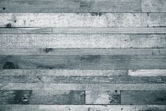 Wooden background from the ends of old boards. Toned stock photography