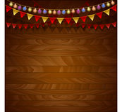 Wooden background. Festive garland and colorful flags. Stock Photography