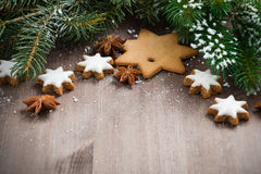 Wooden background with fir branches and cookies, selective focus Royalty Free Stock Photos