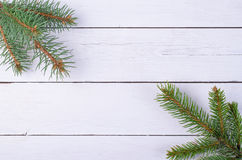 Wooden background and fir branches with space for your text. Royalty Free Stock Photo