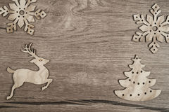 Wooden background with flat Christmas toys Stock Images