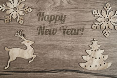 Wooden background with flat wooden toys Stock Image