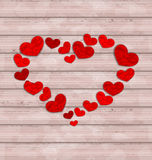 Wooden background with frame made in hearts for Valentines Day Royalty Free Stock Images