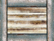 Wooden background framed by old painted boards Royalty Free Stock Photography