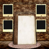 Wooden background with frames for photo. And old book Royalty Free Stock Image