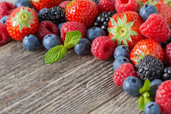 Wooden background with fresh berries, selective focus Royalty Free Stock Photos