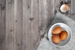 Wooden background with fresh raw eggs. Top view and empty space Stock Photos