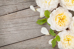 Wooden background with fresh rose flowers Royalty Free Stock Photo