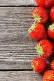 Wooden background with fresh strawberries, top view Royalty Free Stock Images