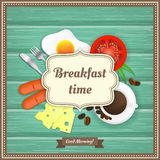 Wooden background with fried egg, sausage, coffee, tomato, cheese, fork and knife Stock Photos