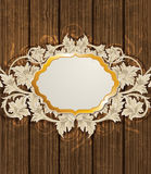 Wooden background and golden label Royalty Free Stock Images