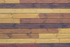 wooden pallets background. wooden background of gorizontal brown and yellow pallets royalty free stock image