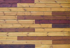 Wooden background of gorizontal yellow and brown pallets. Wooden background of gorizontal brown and yellow pallets Stock Images