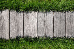 Wooden background with grass border Royalty Free Stock Photo