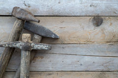 Wooden background with a hammer, home improvement Stock Photos