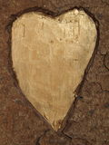 Wooden background with a heart. Wooden background with a carved heart Royalty Free Stock Images