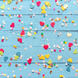 Wooden background with heart and dot confetti Royalty Free Stock Image