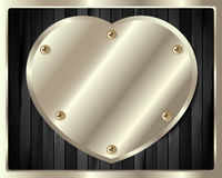 Wooden background with a heart of silver Royalty Free Stock Photos