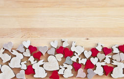 Wooden background with hearts and easter bunnies Royalty Free Stock Photos