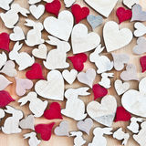 Wooden background with hearts and easter bunnies Stock Photo