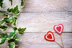 Wooden background with hearts. Wooden background with red hearts for Valentine`s day royalty free stock photo