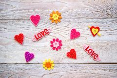 Wooden background with hearts. Flowers and the word LOVE on Valentine`s day royalty free stock photos