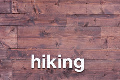 Wooden Background with Hiking in White Letters Royalty Free Stock Image