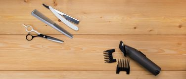 Wooden background. items are for cutting hair. menfolk. electra hair clipper. Light wooden background. items are for cutting hair. menfolk. electra hair clipper stock photo