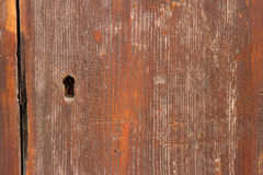 Wooden background with keyhole Royalty Free Stock Photography