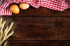 Wooden background, kitchen towel and cooking ingredients stock images