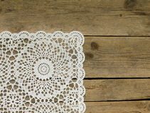 Wooden background with  lace napkin Stock Photos