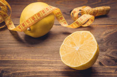 Wooden background about lemon and centimeter. Healthy concept with lemon and centimeter Royalty Free Stock Image