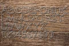 Wooden background with letters and numbers Royalty Free Stock Photos