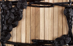 Wooden background with licorice Stock Images