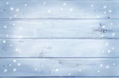 Wooden background - light blue with snowflakes. Winter background - wood texture royalty free stock images