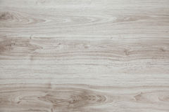 Wooden background with light and gray patches. Stock Image