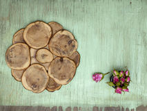 Wooden background with little pink roses. Grunge mockup. Green old painted texture. Stock Photo