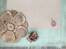 Wooden background with little pink roses. Grunge mockup. Green old painted texture. Kraft paper surface. Stock Photos