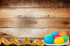 Wooden background with multicolored eggs Royalty Free Stock Photo