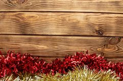 Wooden background new year holiday shiny tinsel stock photos