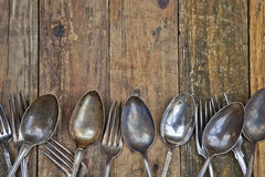 Wooden background with old cutlery Royalty Free Stock Photos