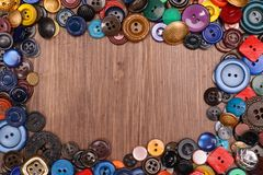 Wooden background with old fashion assorted buttons.  Stock Images